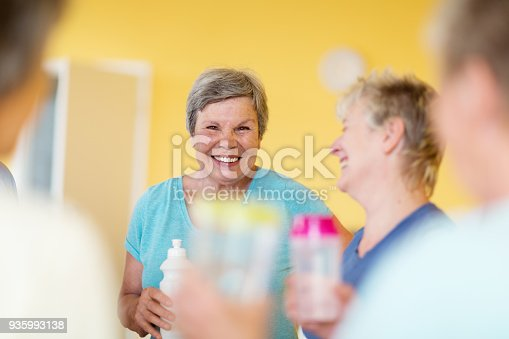 istock Active senior women chatting after yoga class, enjoying the after effects of exercising 935993138