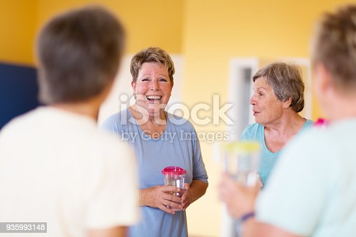 istock Active senior women chatting after yoga class, enjoying the after effects of exercising 935993148
