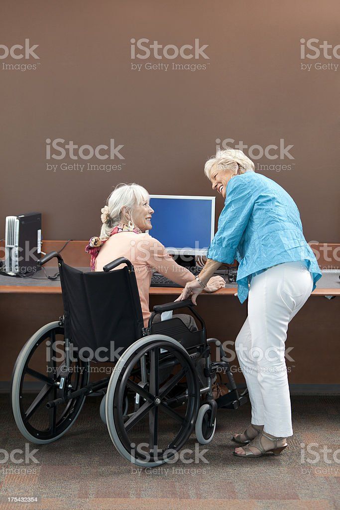 Active Seniors At Computer Station stock photo