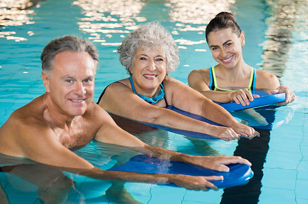 Active seniors at water fitness - foto stock