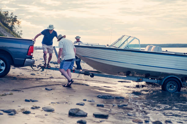 Active seniors brothers on a fishing trip. stock photo