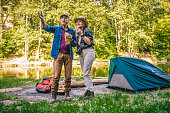 senior couple enjoying their weekend together camping in nature