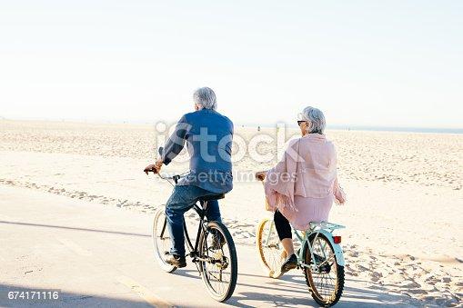 istock Active seniors couple on bike 674171116