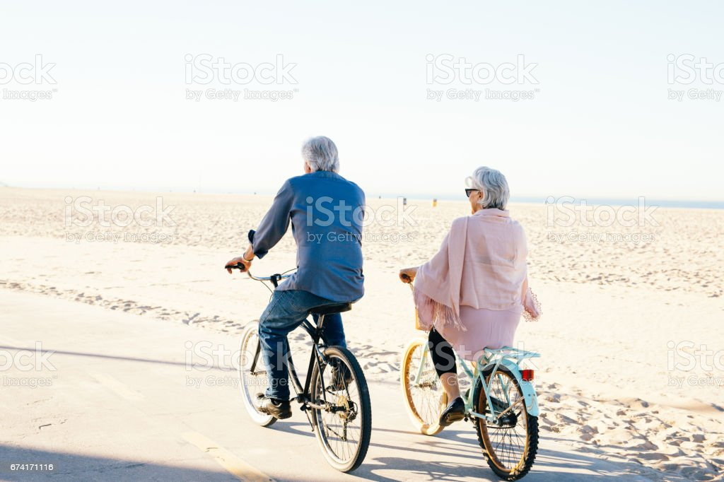 Active seniors couple on bike stock photo