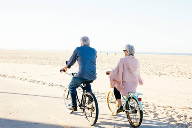 Active seniors couple on bike stock photo