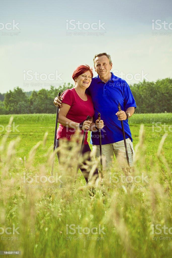 Active seniors doing nordic walking royalty-free stock photo
