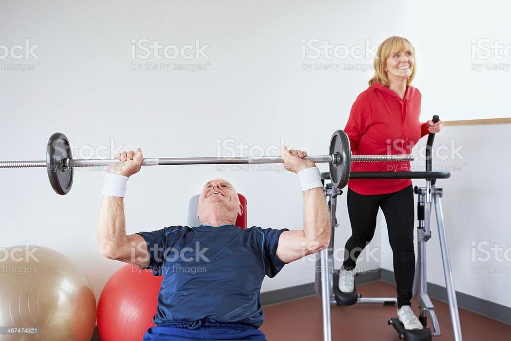 Active seniors exercising in the gym stock photo