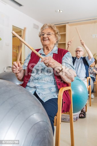 istock Active Seniors Having Physical Theraphy In The Retirement Home 673350786