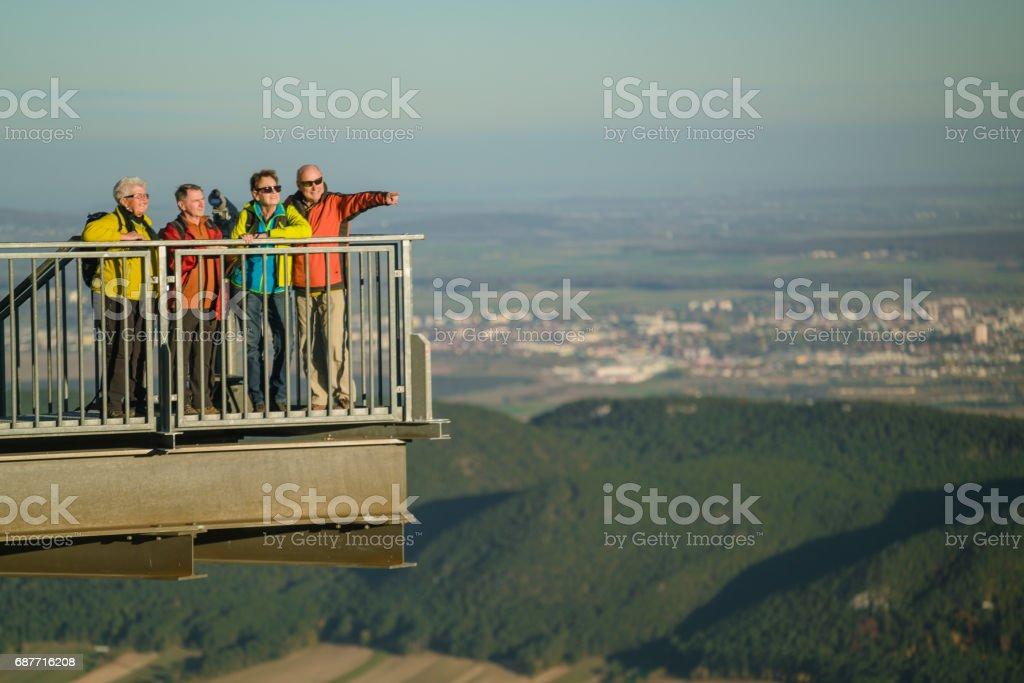 active seniors hiking viewpoint stock photo