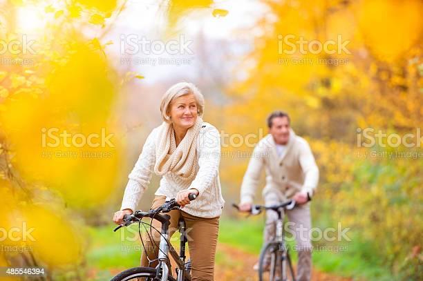 Active Seniors Riding Bikes Stock Photo - Download Image Now