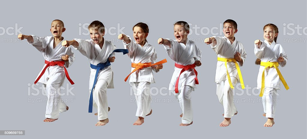 Active six sportsmen are beating punch hand stock photo
