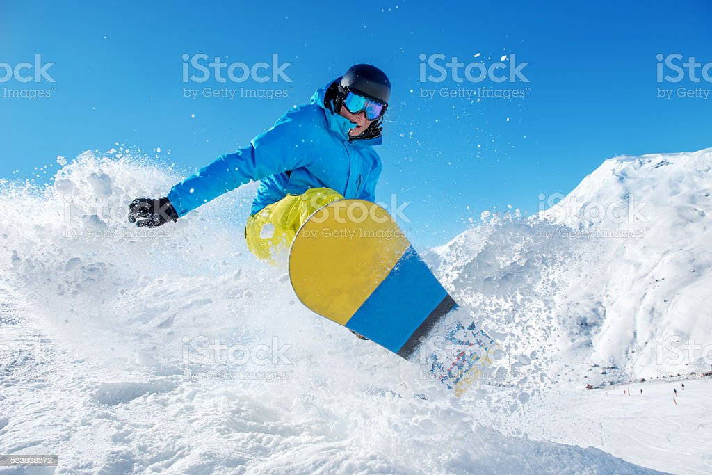 Active snowboarder jumping stock photo