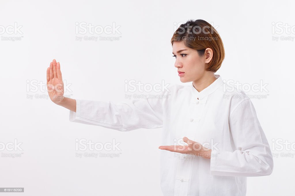 active, strong, confident asian woman practice kungfu stock photo