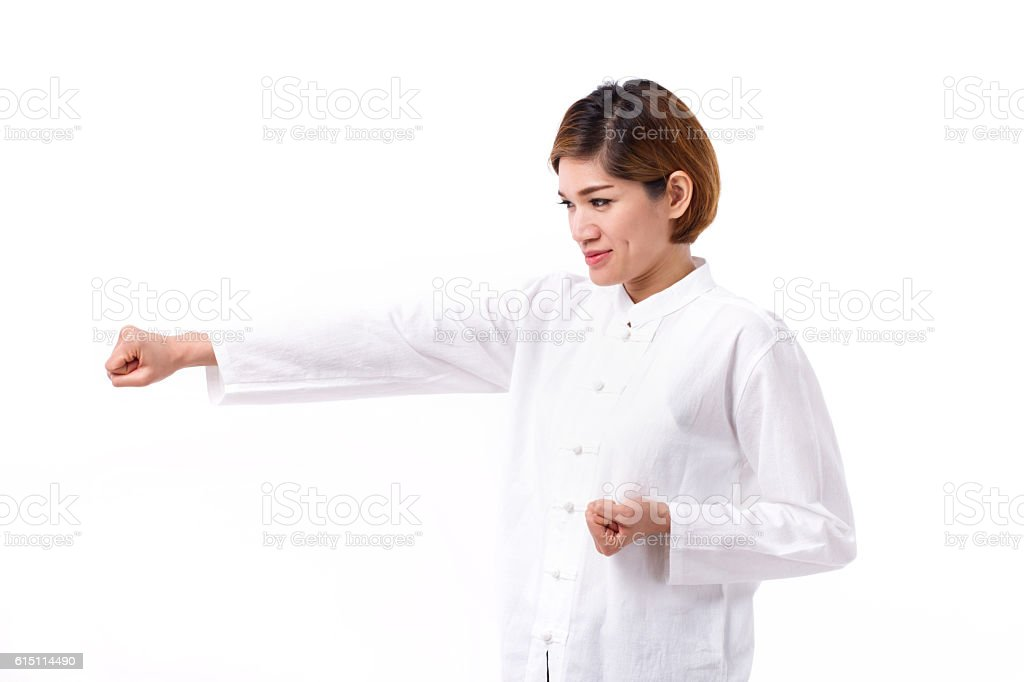 active, strong, confident asian woman punching, practice kungfu stock photo