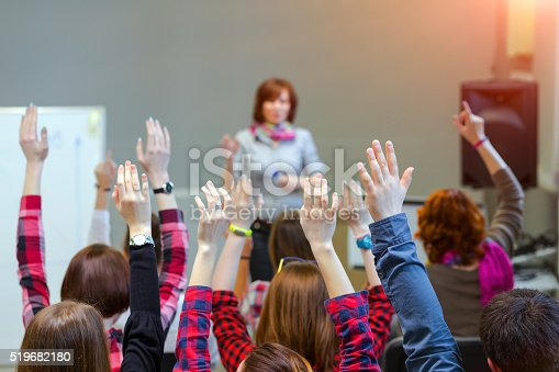 istock Active Students raising Arms up ready to answer Teachers Question 519682180