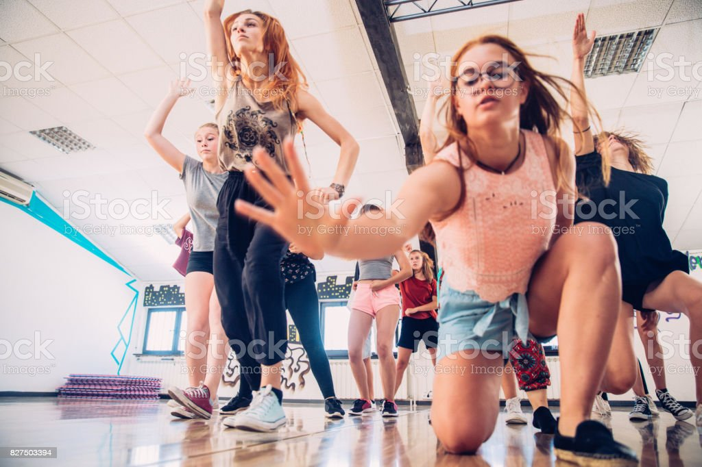 Active Teenage Girls Learning to Dance Choreography stock photo
