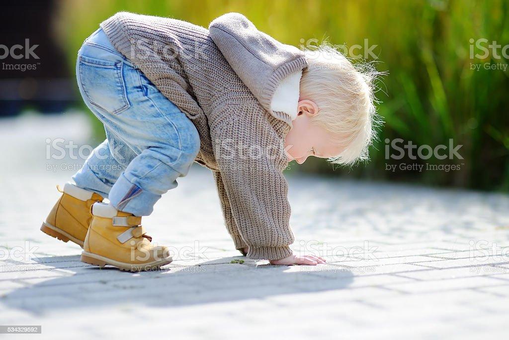 Active toddler boy outdoors stock photo