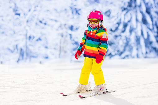 istock Active toddler kid skiing in the mountains 607508578