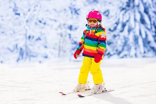 active toddler kid skiing in the mountains - winter austria train bildbanksfoton och bilder