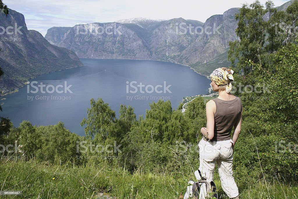 Active woman at the top of mountains over  lake - Royalty-free Adult Stock Photo