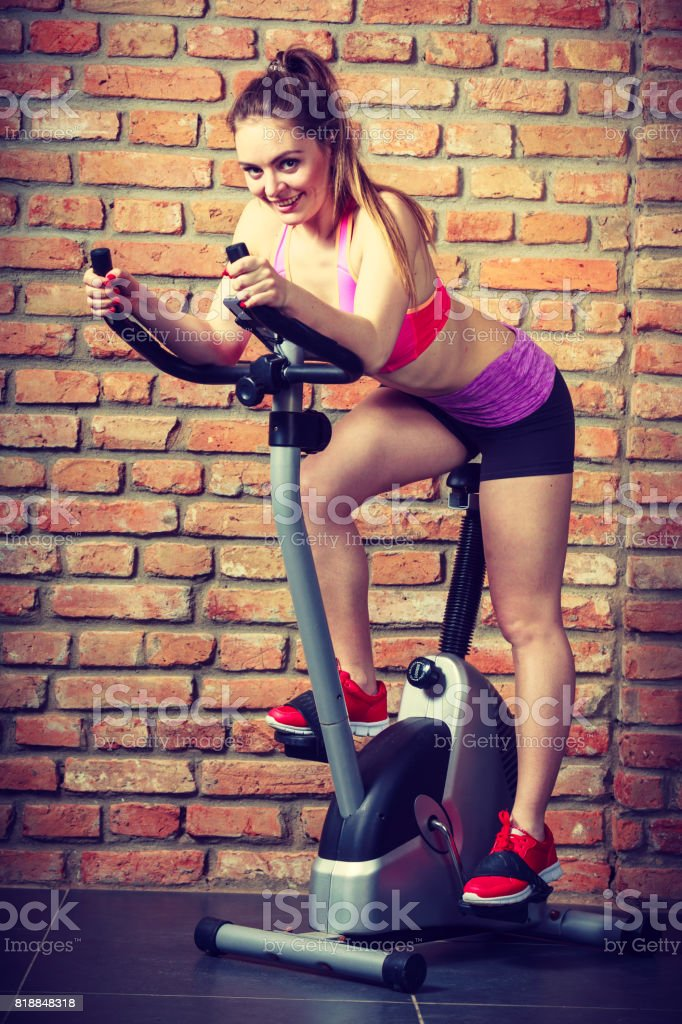 Active woman doing sport biking. stock photo