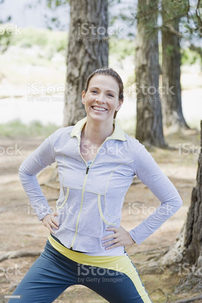 Active woman stretching in remote area royalty-free stock photo