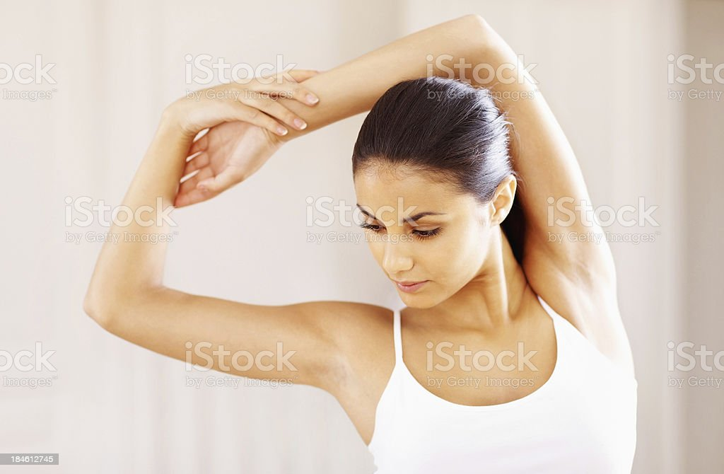 Active woman stretching stock photo