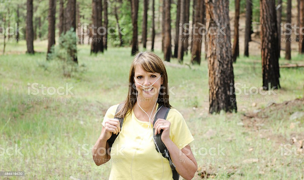 Active Woman Using Therapeutic Oxygen stock photo