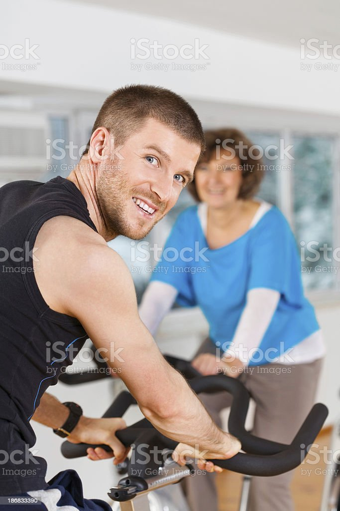 Active Young Man And Mature Woman At The Gym royalty-free stock photo