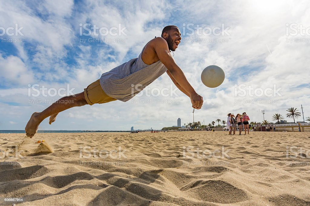 Active Young Man Jumping While Playing Beach Volleyball - Photo