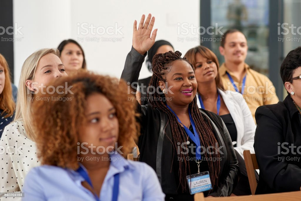 Actively participating in the conference stock photo