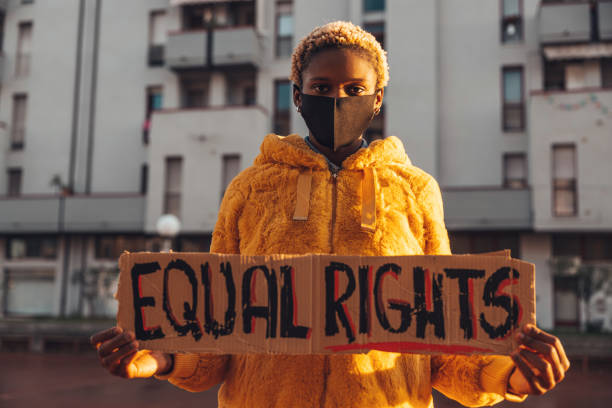 Activist for equal rights Young woman holding a message written on a cardboard civil rights stock pictures, royalty-free photos & images