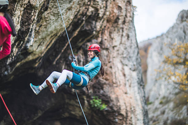 activity of the day - rock climbing stock photos and pictures