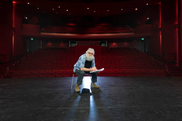 actor, director rehearsal in theatre stock photo
