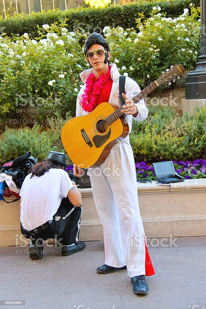 Actor dressed as Elvis Presley poses for the camera stock photo