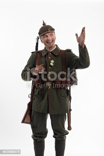 Actor in the form of a German infantryman from the times of the First World War on a white background