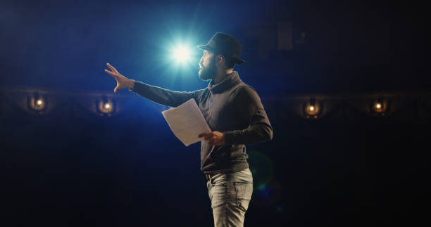 actor performing a monologue in a theater - stage theater stock pictures, royalty-free photos & images