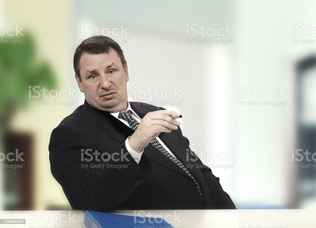 Actor portraying haughty interviewer Middle-aged actor portraying haughty recruiter in stress interview 50-54 Years Stock Photo