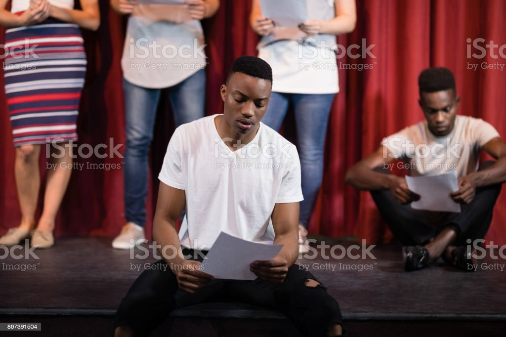 Actor reading his scripts on stage stock photo
