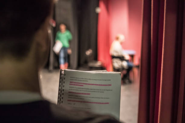 Actor Reading Script From Backstage for Assistance and Preparation stock photo
