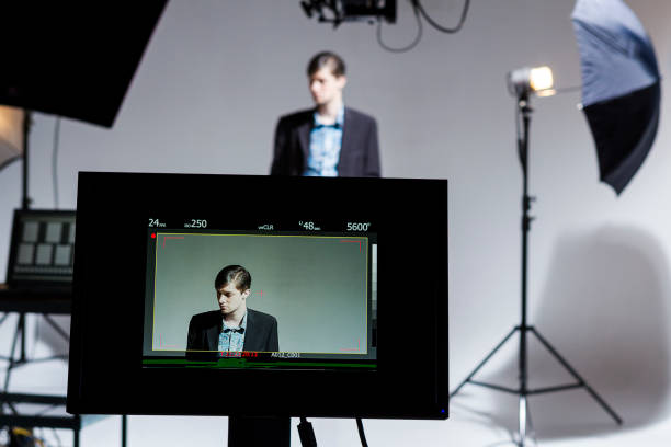 Actor working Behind the Scenes on a Film Set stock photo
