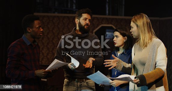 Medium shot of actors and actresses arguing during rehearsal in a theater