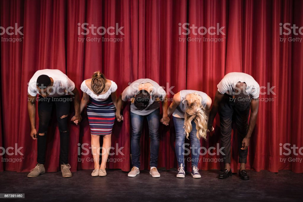 Actors bowing on the stage stock photo