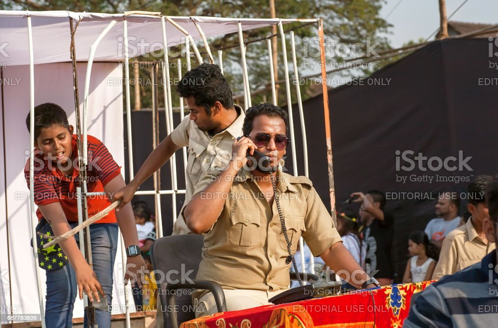 Actors depict corrupt policemen and the iniquity during parade of the traditional Goa carnival stock photo