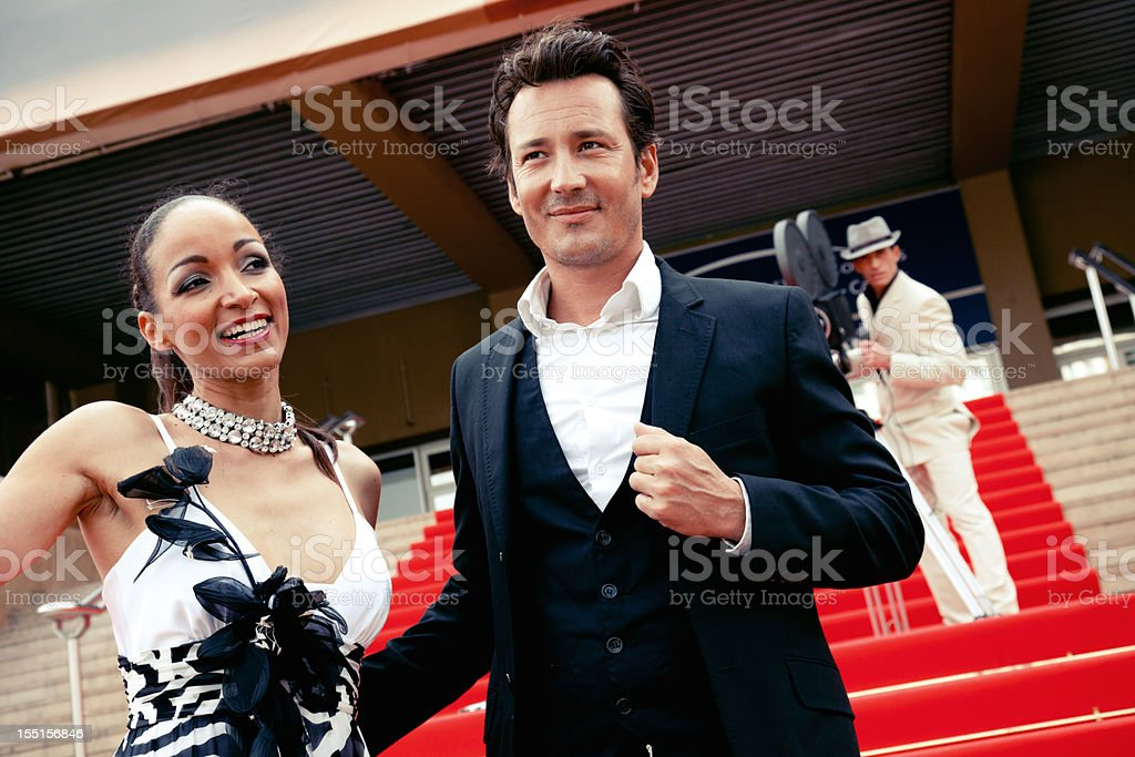 Actors on red carpet and cameraman stock photo