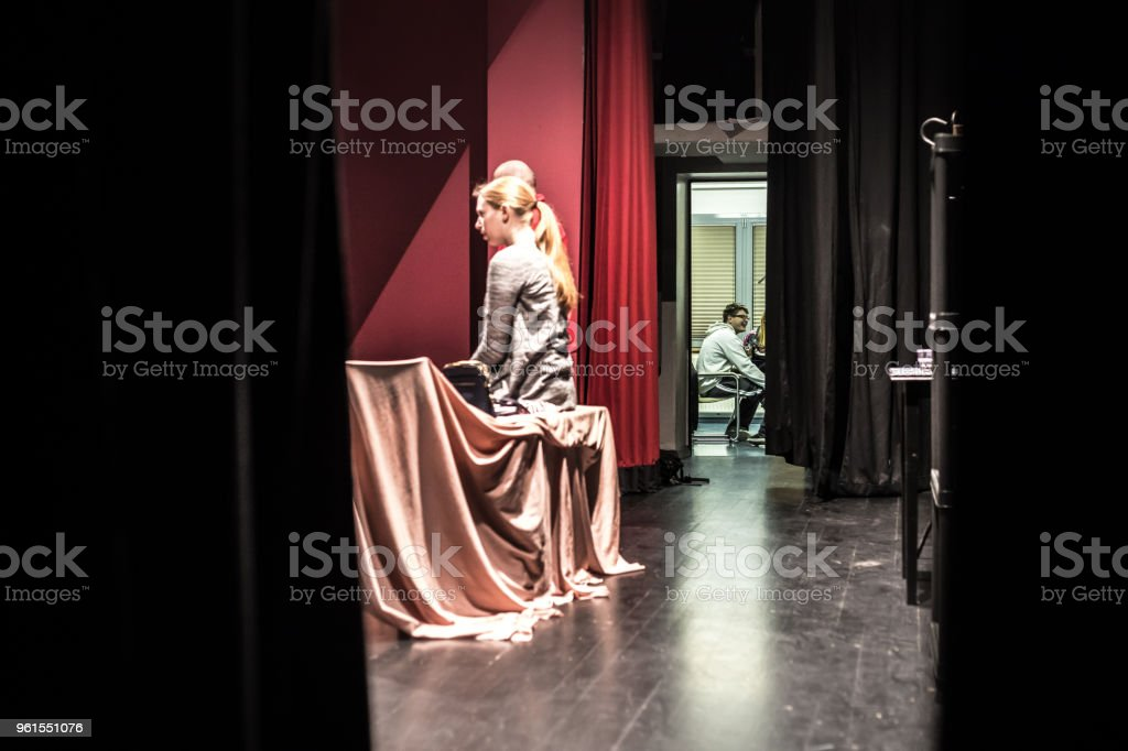 Actors on Stage and Backstage During Theatrical Performance.