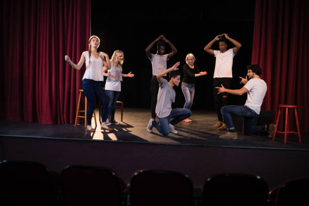 Actors practicing play on stage stock photo