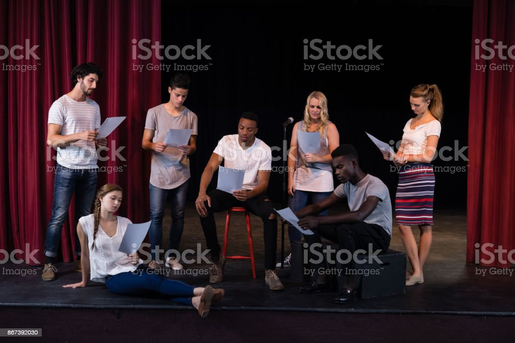 Actors reading their scripts on stage stock photo