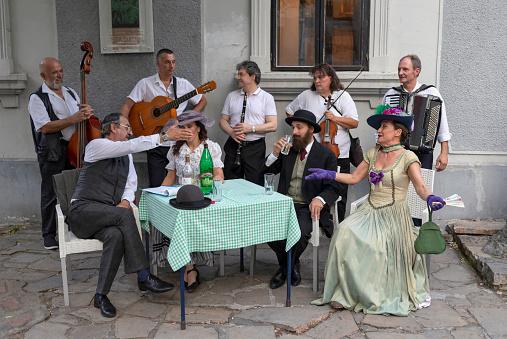 Belgrade, Serbia Jul 5, 2019: Actors recreating city life scenes from early 20th century at the touristic Skadarska Street also known as Skadarlija.