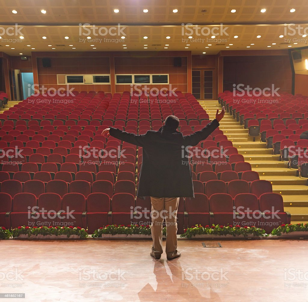 actors rehearsing on stage stock photo